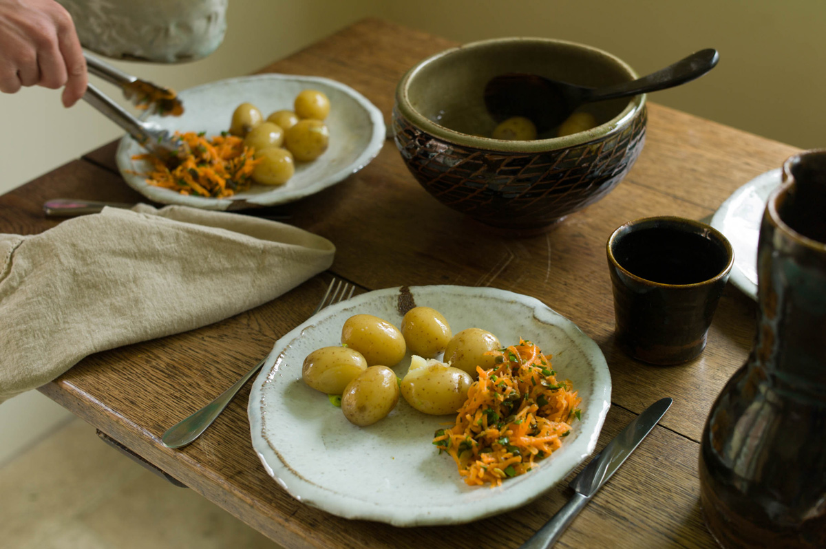 Tableware by potters Anne Mette Hjortshøj (plates, beakers) and Phil Rogers (large bowl)