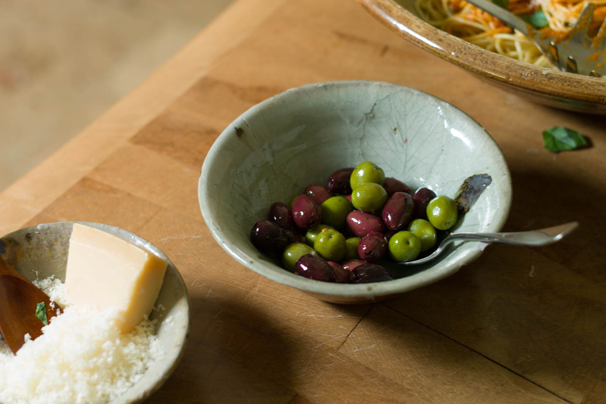 Olives from a Nic Collins celadon glazed bowl with leaf impression
