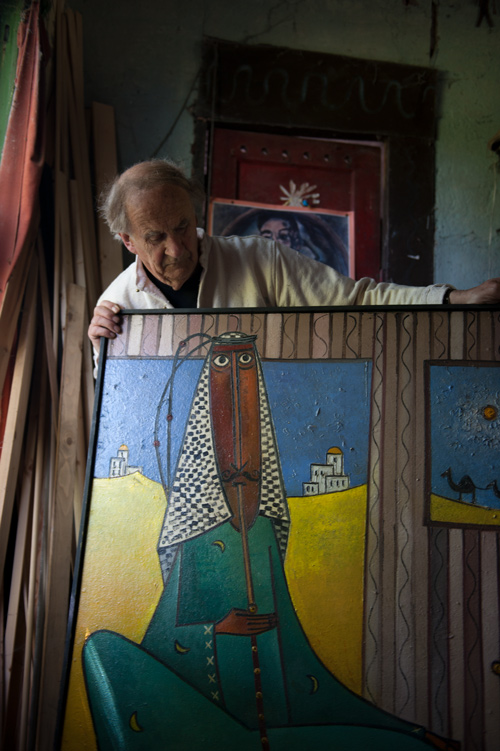 Kuhn with a painting in his Lincolnshire studio